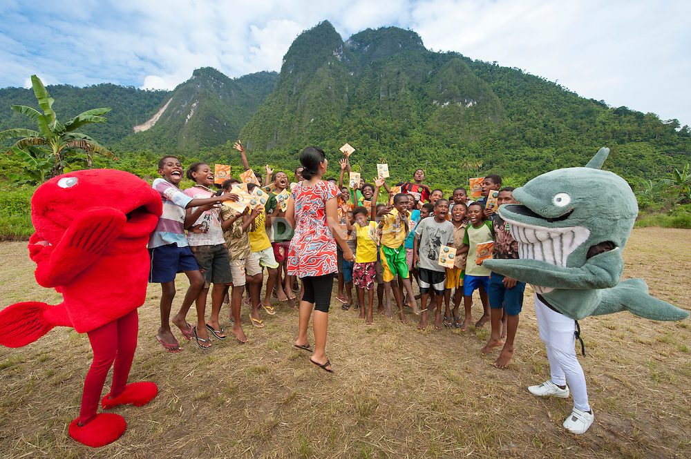 Red Snapper and Bryde's Whale mascots pay a visit to Lobo Village, getting school kids jazzed about conservation in Triton Bay, Papua.