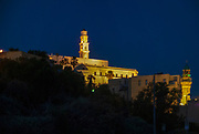 Old Jaffa at dawn. The illuminated belfry of the St Peter church in the centre