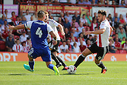 Brentford forward Scott Hogan (9)  dribbles into the box during the EFL Sky Bet Championship match between Brentford and Ipswich Town at Griffin Park, London, England on 13 August 2016. Photo by Matthew Redman.