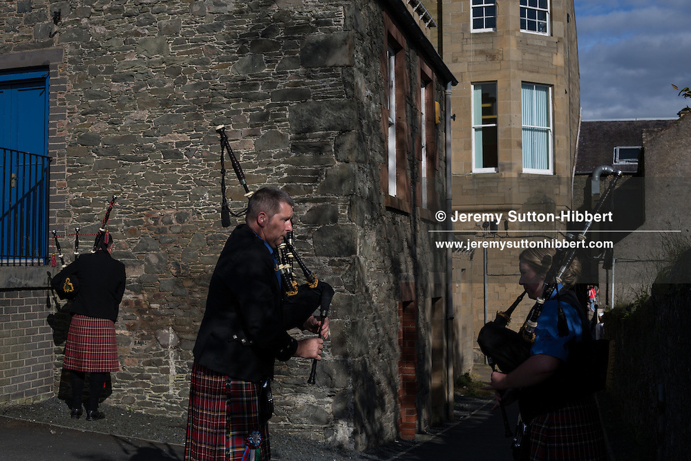 Bagpipers arrive and tune up for the Thursday evening 'Cryin' o' The Burley' event, where townsfolk walk around the town and the common riding is proclaimed by a town crier. The Common Riding festivities in Selkirk, with Royal Burgh Standard Bearer Martin Rodgerson, in Selkirk, Scotland, Thursday 13th June 2013. <br /> N55&deg;32.842'<br /> W2&deg;50.557'