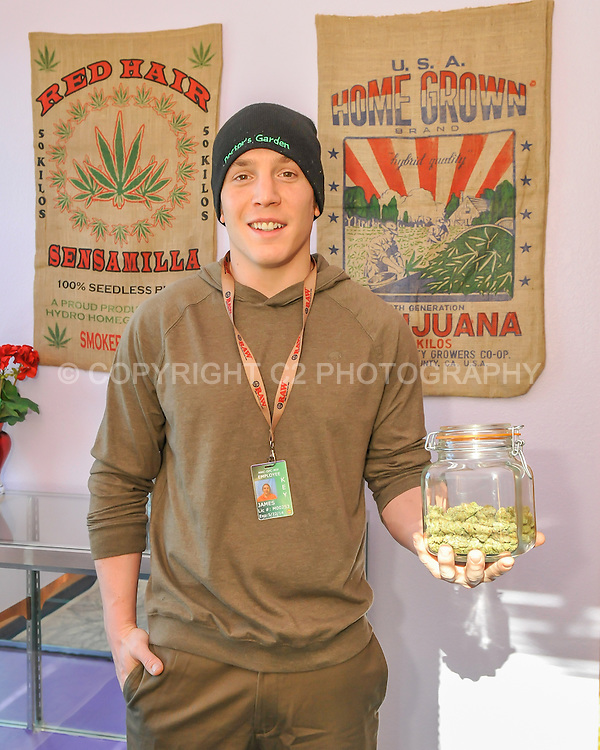 James Leonard stands for a portrait in his retail marijuana store in Carbondale, Colorado.