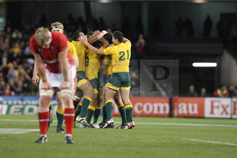 © Licensed to London News Pictures. 16/06/2012. Etihad Stadium, Melbourne Australia. Australian players celebrate after winning the match after the siren as a Welsh player shows disapointment during the 2nd Rugby Test between Australia Wallabies Vs Wales . Photo credit : Asanka Brendon Ratnayake/LNP