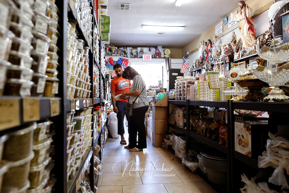 Customers shop the Good Old Days Spices shop off Main Street in El Cajon, Calif., Aug. 14, 2015. Run by a Chaldean family, the store stocks religious statues, rosaries and crucifixes amid a variety of Middle Eastern groceries and sundries. (Nancy Wiechec for ONE magazine)