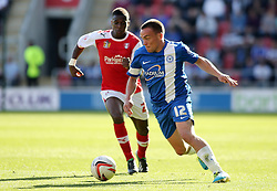 Peterborough United's Paul Taylor in action with Rotherham United's Kieran Agard - Photo mandatory by-line: Joe Dent/JMP - Tel: Mobile: 07966 386802 28/09/2013 - SPORT - FOOTBALL - New York Stadium - Rotherham - Rotherham United V Peterborough United - Sky Bet One