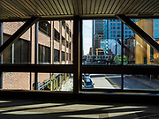 03 MAY 2017 - MINNEAPOLIS, MN:  A skyway in Minneapolis. The skyways are enclosed pedestrian overpasses that connect downtown buildings. The Minneapolis Skyway was started in the early 1960s as a response to covered shopping malls in the suburbs that were drawing shoppers out of the downtown area. The system grew sporadically until 1974, when the construction of the IDS Center and its center atrium, called the Crystal Court, served as a hub for the downtown skyway system. There are 8 miles of skyways, connecting most of the downtown buildings from Target Field (home of the Minnesota Twins) to US Bank Stadium (home of the Minnesota Vikings). In the last five years many upscale downtown apartment buildings and condominium developments have been added to the system, allowing downtown residents to live and work downtown without going outside.   PHOTO BY JACK KURTZ