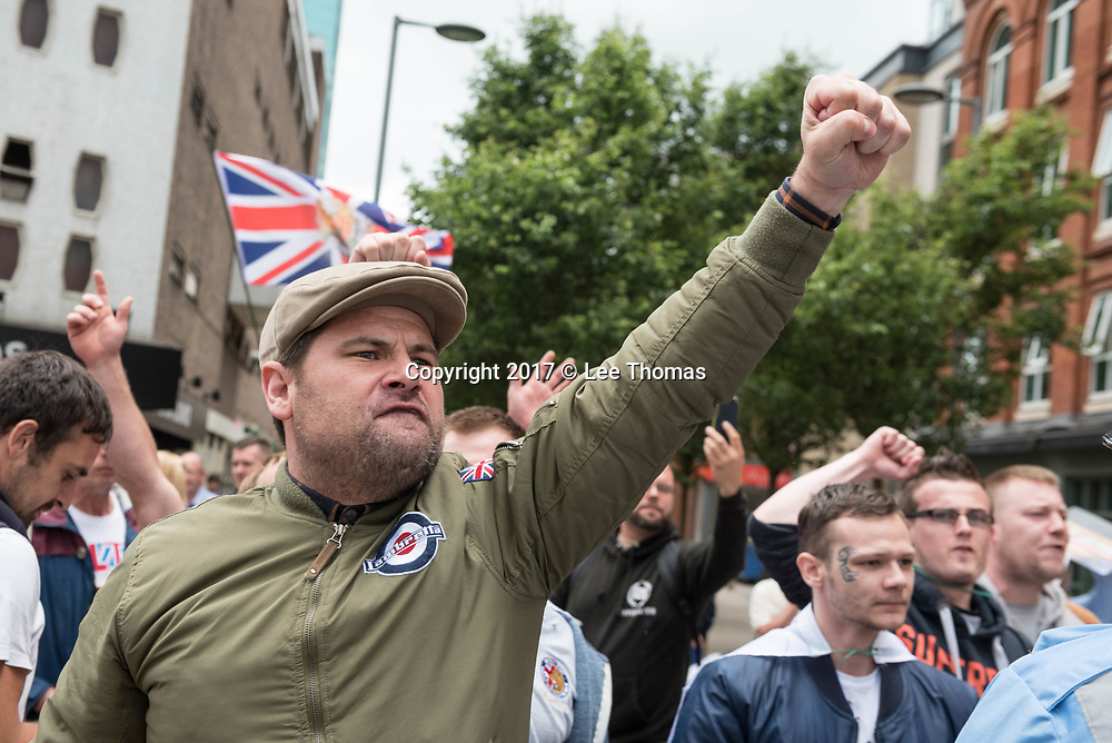 Birmingham, West Midlands, UK. 24th June 2017. Pictured:  / Up to two hundred Britain First supporters take to the streets of the Birmingham to protest against muslims living in the area and beyond in the UK.  Scores of police formed a barrier between the far-right supporters and a vocal anti-fascist group consisting of  Birmingham Unite Against Fascism, trades unions, the muslim community and Love Music Hate Racism. The Britain First demonstration comes at a time when thousands of muslims take to the shops of Birmingham to prepare for  Eid. // Lee Thomas, Tel. 07784142973. Email: leepthomas@gmail.com  www.leept.co.uk (0000635435)