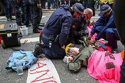 © Licensed to London News Pictures. 25/04/2019. London, UK. City of London Police using drilling equipment un-bonds environmental activists from Extinction Rebellion Movement Group who glued themselves on Fleet Street in City of London as part of their ongoing action demanding decisive action from the UK Government on the environmental crisis Photo credit: Dinendra Haria/LNP