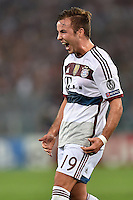 Uefa Champions League-2014-2015 / Group E / <br /> As Roma vs Fc Bayern Munich 1-7  ( Olympic Stadium, Roma - Italy ) <br /> Mario Goetze of Fc Bayern Munich (Middle) celebrates after his Goal (0-2) ,<br /> during the match between As Roma and Fc Bayern Munich