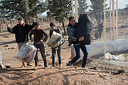 Syrian - Turkish border in Kilis, newly arrived refugees from Aleppo had to escape Turkish border controls and cross the border illegally.  Because Turkey is saturated with refugees, they will likely get no  help, no work, and no place in a refugee camp. Many refugees return to Aleppo after a few month in Turkey, a country that is now saturated with refugees.