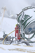 A Nubs Nob employee works on a 60 inch fan gun that the ski area is using to make snow for the upcoming ski season.  Both Nubs Nob and Boyne Highlands will be open for skiing this weekend in Harbor Springs.