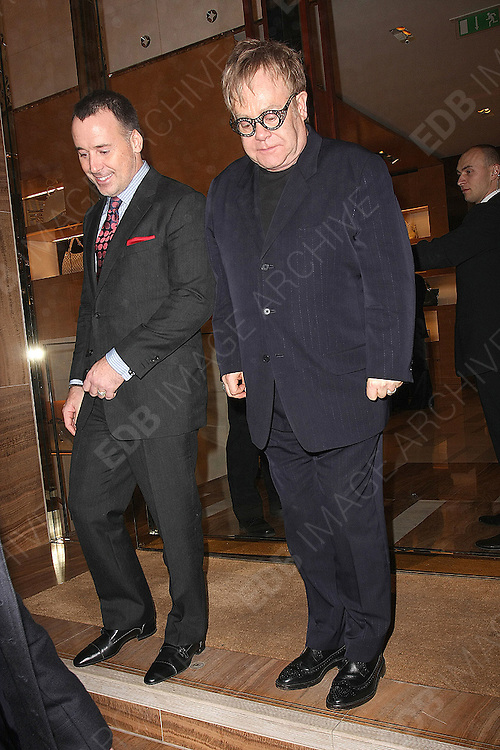 01.FEBRUARY.2011. LONDON<br /> <br /> ELTON JOHN AND DAVID FURNISH LEAVING A PARTY AT LOUIS VUITTON FLAGSHIP STORE IN MAYFAIR. ELTON LOOKED RATHER TIRED, PERHAPS SLEEPLESS NIGHTS?<br /> <br /> BYLINE: EDBIMAGEARCHIVE.COM<br /> <br /> *THIS IMAGE IS STRICTLY FOR UK NEWSPAPERS AND MAGAZINES ONLY*<br /> *FOR WORLD WIDE SALES AND WEB USE PLEASE CONTACT EDBIMAGEARCHIVE - 0208 954 5968*