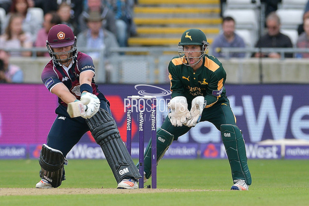 Ben Duckett reverse sweeps Steven Mullaney (not shown) watched on by a surprised Chris Read during the NatWest T20 Finals Day 2016 match between Nottinghamshire County Cricket Club and Northamptonshire County Cricket Club at Edgbaston, Birmingham, United Kingdom on 20 August 2016. Photo by Simon Trafford.