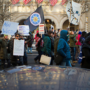 Protest and march from in front of the U.S. Capitol to the EPA, about the North Dakota Access Pipeline, as well as the effort to free Leonard Peltier.  Saturday, December 10, 2016. John Boal PhotographyDemonstrators marched past the new Trump hotel on Pennsylvania Ave, on their way to the EPA, Saturday, December 10, 2016.  The protest was in support of the demonstrations at Standing Rock, North Dakota, regarding the North Dakota Access Pipeline, as well as the effort to free Leonard Peltier. John Boal Photography