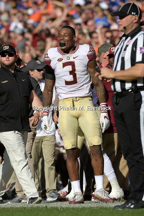 Florida State defensive back Derwin James (3) reacts to a play on the sideline during the second half of an NCAA college football game against Florida Saturday, Nov. 25, 2017, in Gainesville, Fla. FSU won 38-22. (Photo by Phelan M. Ebenhack)