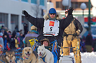 March 7th, 2009:  Anchorage, Alaska - Rick Larson of Sand Coulee, Montana waves to the fans along 4th Avenue at the start of the 2009 Iditarod.