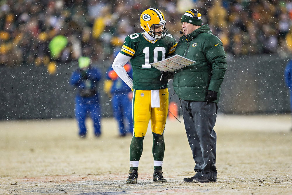 GREEN BAY, WI - DECEMBER 22:  Head Coach Mike McCarthy and Matt Flynn #10 of the Green Bay Packers talk on the field during a game against the Pittsburgh Steelers at Lambeau Field on December 22, 2013 in Green Bay, Wisconsin.  The Steelers defeated the Packers 38-31.  (Photo by Wesley Hitt/Getty Images) *** Local Caption *** Matt Flynn; Mike McCarthy