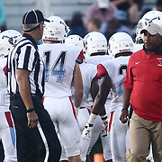 Delaware State Head Coach KENNY A. CARTER, (RIGHT) speaks to the referee during a week one game between the Delaware Blue Hens and the Delaware State Hornets, Thursday, Sept. 01, 2016 at Tubby Raymond Field at Delaware Stadium in Newark, DE.