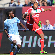 Andrew Farrell, (right), New England Revolution, challenged by Steven Mendoza, NYCFC, during the New York City FC Vs New England Revolution, MSL regular season football match at Yankee Stadium, The Bronx, New York,  USA. 26th March 2016. Photo Tim Clayton