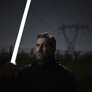 Orlando Volpe, a member of the &quot;No Power Line&quot; committee, holding a neon tube which, because of the Tesla effect, ignites spontaneously under the wires of a power line in the valley of Frentano.<br /> Sant'Onofrio (CH)