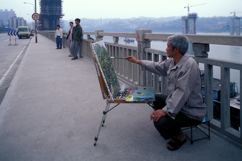 China, Chongqing Province, Chongqing, (MR) Xiong Ji Yan paints scene of home that was scheduled for demolition