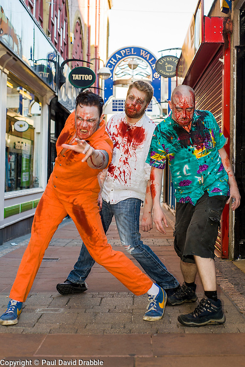 Slingshots Top Zombies Alex Noble, Noel Davies-Atack and Paul Byrne on Chapel Walk Sheffield on Tuesday evening ahead of the game 2.8 Hours Later which reaches the city in August <br /> <br /> 30 June 2015<br />  Image &copy; Paul David Drabble <br />  www.pauldaviddrabble.co.uk