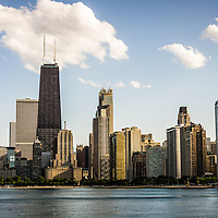 Picture of Chicago buildings with Hancock building and other popular downtown Chicago city buildings. The John Hancock Center building is one of the world's tallest skyscrapers and is a famous fixture in the Chicago skyline. Photo is high resolution and was taken in 2012.