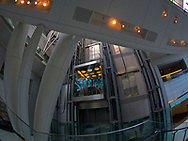 School kids ride the elevator at The Rose Center of Earth and Space, designed by James Stewart Polshek, at the American Museum of Natural History, New York City.