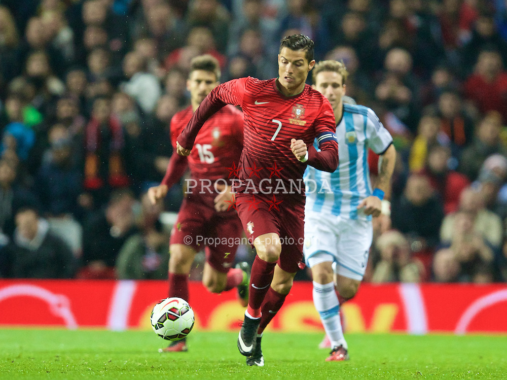MANCHESTER, ENGLAND - Tuesday, November 18, 2014: Portugal's captain Cristiano Ronaldo in action against Argentina during the International Friendly match at Old Trafford. (Pic by David Rawcliffe/Propaganda)