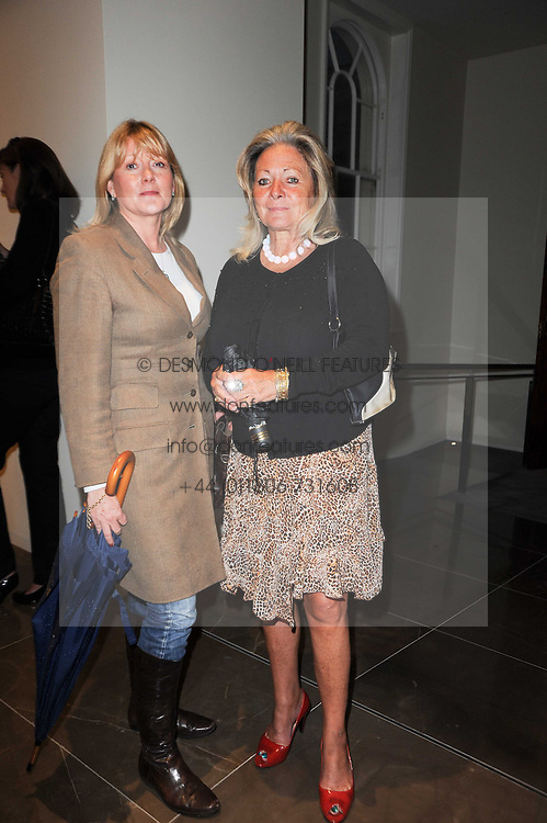 Left to right, LUCY McGINLEY and the HON.ANNETTE HOWARD at reception to see the installation of Horse at Water by Nic Fiddian-Green at Marble Arch, London on 14th September 2010.