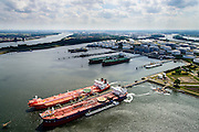 Nederland, Zuid-Holland, Rotterdam, 10-06-2015; 7e Petroleumhaven met Vopak Terminal Europoort in de achtergrond. In de voorgrond de crude oil tankers Hilda Knutsen en Navion Hispania (met bunker schip aan haar zijde).<br /> 7th Petroleum port with crude oil tankers.<br /> luchtfoto (toeslag op standard tarieven);<br /> aerial photo (additional fee required);<br /> copyright foto/photo Siebe Swart