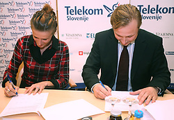 Sonja Roman and President of AZS dr. Peter Kukovica when Athletic Federation of Slovenia (AZS) and top Slovenian athletes sign a contract of sponsorship, on February 14, 2008 in M-Hotel, Ljubljana, Slovenia. (Photo by Vid Ponikvar / Sportal Images)