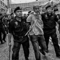 Malaysian policemen arrested a protestor during a crackdown on Bersih rally calling for electoral reforms  in Kuala Lumpur, Malaysia 9 July 2011.<br /> With national elections due by 2013, the opposition backed protest, Bersih is demanding reforms including measures to prevent vote-buying and fraud.