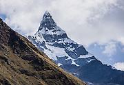Day 1 of 10: The narrow ridge of Nevado Chacraraju (20,039 ft / 6108 m) sharpens like a dagger when seen edge-on from Huaripampa Valley, near Vaqueria. Trek 10 days around Alpamayo, in Huascaran National Park (UNESCO World Heritage Site), Cordillera Blanca, Andes Mountains, Peru, South America.