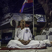 Cambodian Buddhist nuns pray during early morning hours outside the former National Assembly prior to funeral services for former Cambodian King Norodom Sihanouk Friday, Feb. 1, 2013 in Phnom Penh.