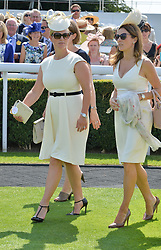 Left to right, ZARA TINDALL and NATALIE PINKHAM at the 2014 Glorious Goodwood Racing Festival at Goodwood racecourse, West Sussex on 31st July 2014.