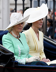 Camilla, Duchess of Cornwall, and Catherine, Duchess of Cambridge  ride in an open carriage during Trooping the Colour in London