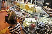 Young girl in a candy store. Photographed in Prague Czech Republic