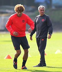 Manchester United manager Jose Mourinho and Marouane Fellaini - Mandatory by-line: Matt McNulty/JMP - 14/09/2016 - FOOTBALL - Manchester United - Training session ahead of Europa League Group A match against Feyenoord