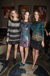Left to right, LADY ALICE MANNERS, LADY ELIZA MANERS and LADY VIOLET MANNERS at the Tatler Little Black Book Party at Home House Member's Club, Portman Square, London supported by CARAT on 11th November 2015.