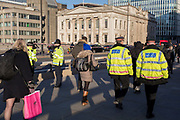 Three days after the killing of Jack Merritt, 25, and Saskia Jones, 23, by the convicted teorrorist Usman Khan at Fishmongers' Hall on London Bridge, police officers make a high-profile presence to ensure the public feel safe, in the City of London, on 2nd December 2019, in London, England.