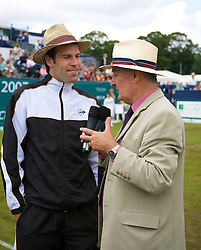 Liverpool, England - Saturday, June 16, 2007: Greg Rusedski chats with BBC Radio Merseyside's Alan Jackson after withdrawing with an injured shoulder from the Liverpool International Tennis Tournament at Calderstones Park. For more information visit www.liverpooltennis.co.uk. (Pic by David Rawcliffe/Propaganda)