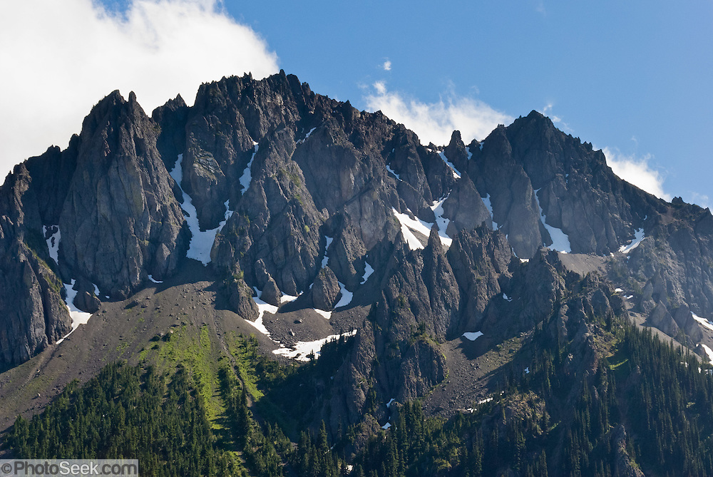 A mountainous wall of sharp rocks rises to the south of Big Quilcene Trail #833.1 near Marmot Pass, in Buckhorn Wilderness, Olympic National Forest, Washington.