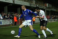 Photo: Rich Eaton.<br /> <br /> Hereford United v Leicester City. Carling Cup. 19/09/2006. Josh Low left of Leicester shields the ball from herefords Martyn Giles