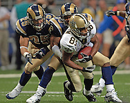 New Orleans wide receiver Az-Zahir Hakim (81) is tackled after making a first down catch by St. Louis defenders Corey Ivy (35) and Mike Furrey (25), in the second quarter at the Edward Jones Dome in St. Louis, Missouri, October 23, 2005.  The Rams beat the Saints 28-17.
