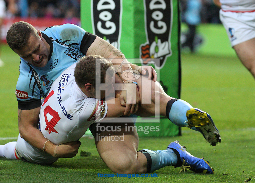 Picture by Stephen Gaunt/Focus Images Ltd +447904 833202<br /> 09/11/2013<br /> Rob Burrow of England held up over the try line against Fiji during the Rugby League World Cup 2013 match at the KC Stadium, Kingston upon Hull.