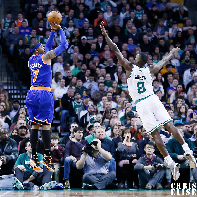 24 January 2013: New York Knicks small forward Carmelo Anthony (7) takes a jumpshot over Boston Celtics power forward Jeff Green (8) during the New York Knicks 89-86 victory over the  at the TD Garden, Boston, Massachusetts, USA.