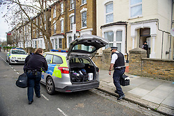 *Caption update* © Licensed to London News Pictures. 19/03/2017. London, UK. Police outside a property on Wilberforce Road whereA one-year-old boy has died and a one-year-old girl sustained critical injuries in Finsbury Park, East London. Photo credit: Ben Cawthra/LNP