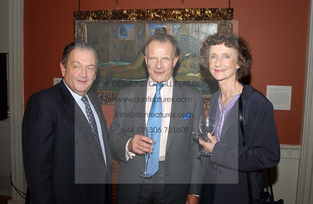 A reception to celebrate the arrival of Deborah Swallow as Director of the Courtauld Institute of Art was held at Somerset House, Strand, London on 9th December 2004.<br />Picture shows:-Left to right, GIUSEPPE ESKENAZI, MR CHRISTOPHER MCLAREN and LINDY, MARCHIONESS OF DUFFERIN & AVA.