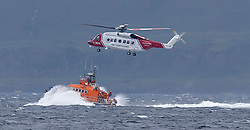 Oban's RNLB Mora Edith MacDonald on a joint exercise with the Maritime & Coastguard Agency rescue helicopter from Prestwick on Loch Linnhe   (c) Stephen Lawson   Edinburgh Elite media