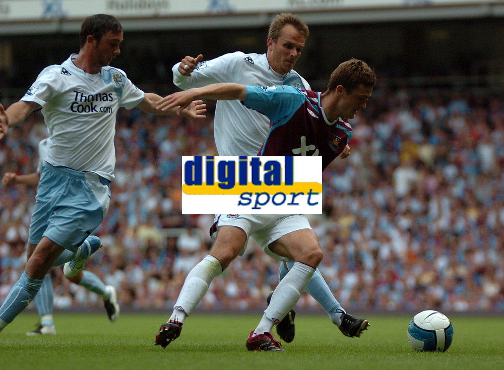 Photo: Tony Oudot. <br /> West Ham United v Manchester City. Barclays Premiership. 11/08/2007. <br /> George McCartney of West Ham goes past Dietmar Hamann and Stephen Ireland of Manchester City